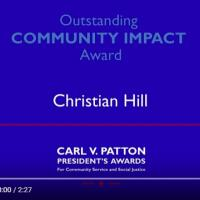 Screenshot of video with text 'outstanding community impact award christian hill'